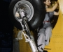 this_woman_worker_at_the_vultee-nashville_is_shown_making_final_adjustments_in_the_wheel_well_of_an_inner_wing_before_the_installation_of_the_landing_gear