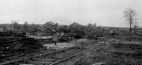French-soldier-standing-by-a-destroyed-railway-station-image-Anton-Orlov