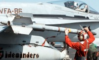 980220-N-0507F-003U.S. Marine Corps Lance Cpl. Leander Pickens, arms an AIM-9 Sidewinder missile on a F/A-18C Hornet as the aircraft is readied for launch from the aircraft carrier USS George Washington (CVN 73) as the ship steams in the Persian Gulf on Feb. 20, 1998.  The Washington battle group is operating in the Persian Gulf in support of Operation Southern Watch which is the U.S. and coalition enforcement of the no-fly-zone over Southern Iraq.  Pickens is from Greenville, Ala.  The Hornet is from Strike Fighter Squadron 86, Naval Air Station Cecil Field, Fla.  DoD photo by Petty Officer 3rd Class Brian Fleske, U.S. Navy.
