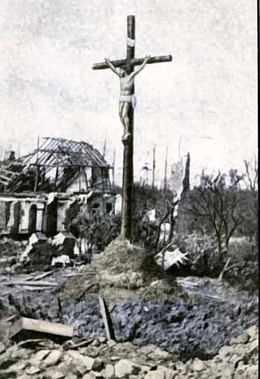 A Crucifix at Neuve Chapelle still standing amidst the ruins.jpg