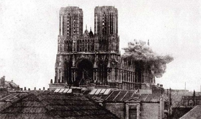 Shell bursting on the cathedral at Rheims.jpg