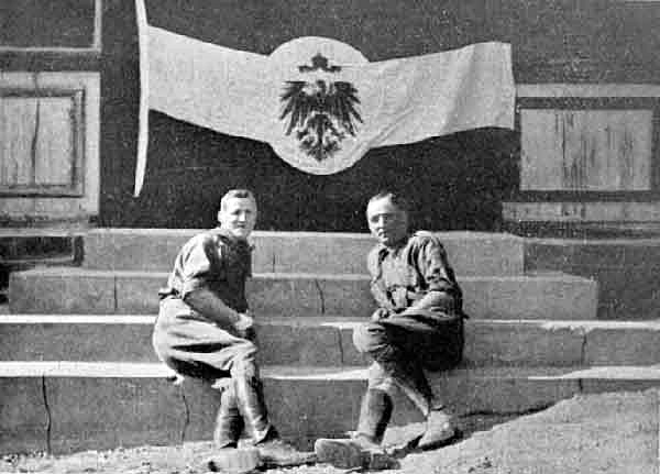 South African officers pose with a captured German flag in Windhuk..jpg