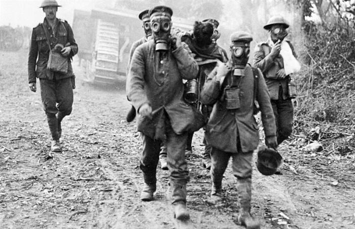 German prisoners wear gas masks in Ypres.jpg