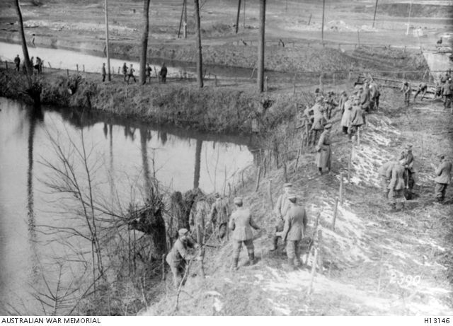 23.3.a La Fere, France, March 1917. German Army soldiers erecting barbed wire