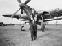 A_Women's_Royal_Naval_Service_radio_mechanic_walks_from_a_Fairey_Barracuda_torpedo_bomber_at_RNAS_Lee-on-Solent,_September_1943._A19294