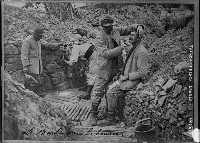 27.7a Barber in a French trench
