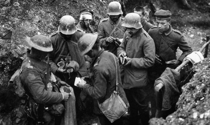 10.1.a British troops sort through the belongings of German prisoners in a trench