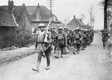 B1 British troops marching through Bethune