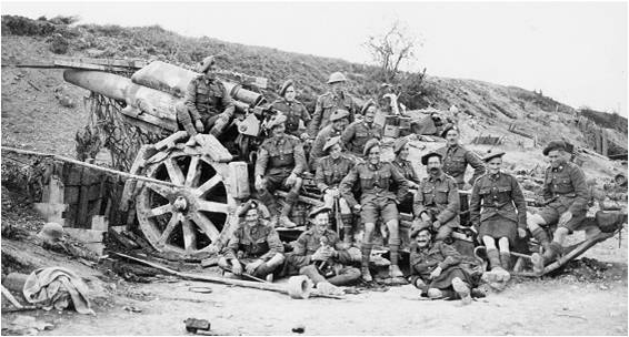 8.8a Men of the 15th Battalion posing with a captured German. artillery