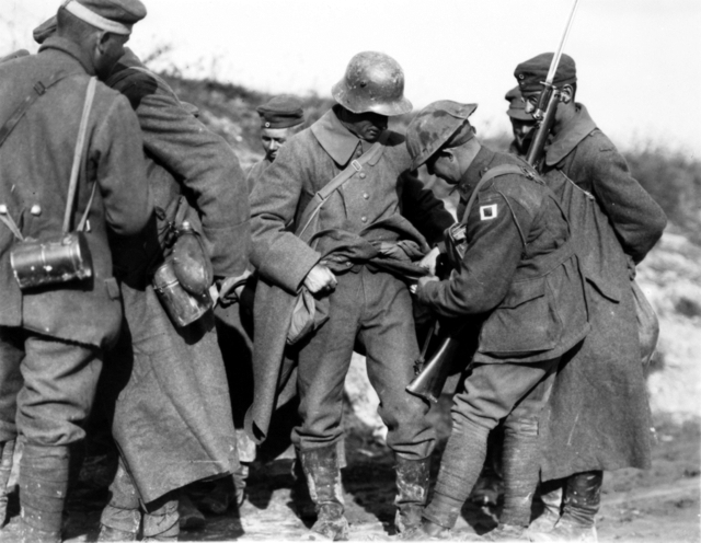 A1 Australian_soldiers_searching_German_POWs_for_souvenirs_in_October_1918